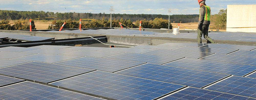 worker-working-on-commercial-solar-roof